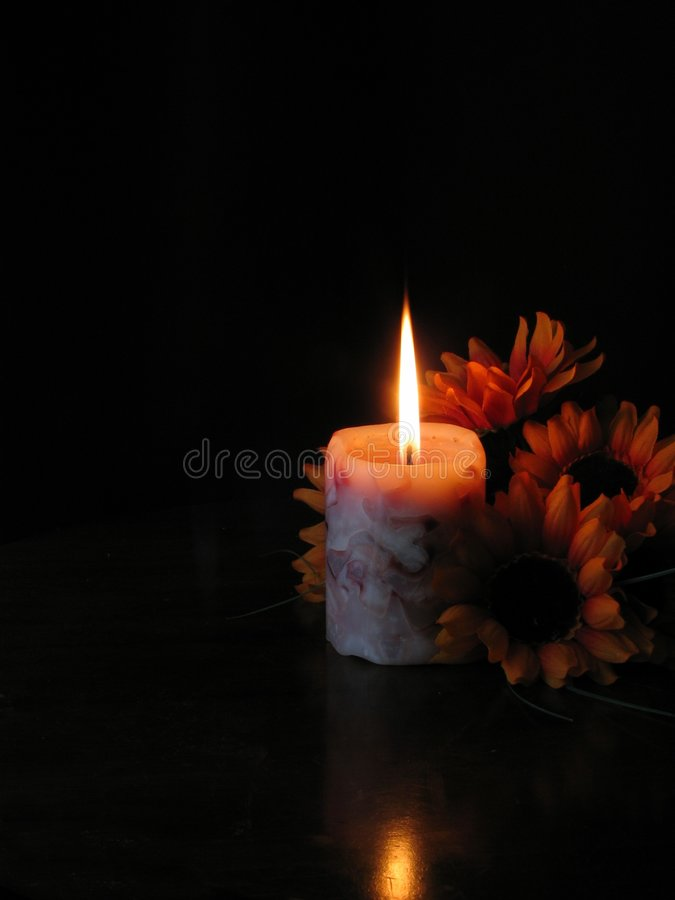 Flowers by candle light. royalty free stock image