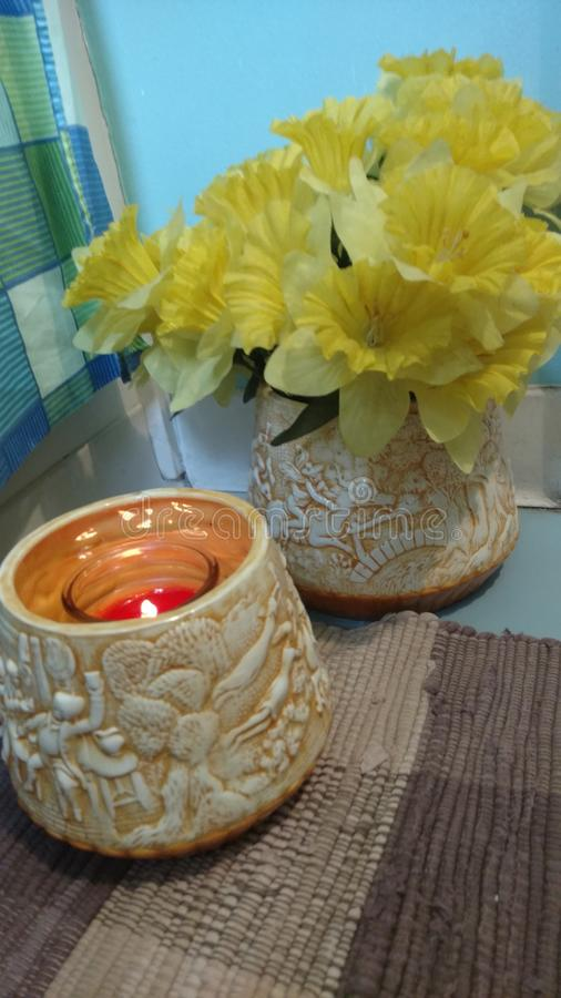 Flowers, candles and bathrooms. Combination of smells and colors royalty free stock photo