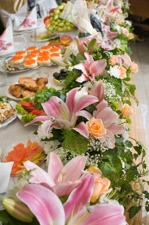 Flowers and celebratory table. royalty free stock image