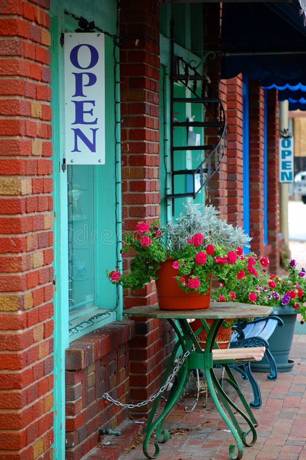 Flowers on Cobblestone walk. Flowers set on bistro tables along a cobblestone walk in a mountain village royalty free stock images