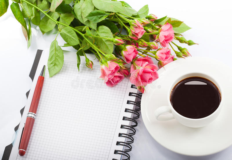 Flowers, coffee and notebook. stock photo