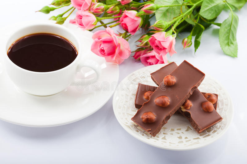 Flowers, coffee and sweets. royalty free stock photos
