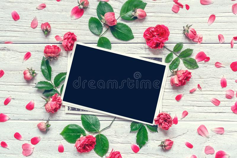 Flowers composition. frame made of pink rose flowers with blank photo frame stock photos