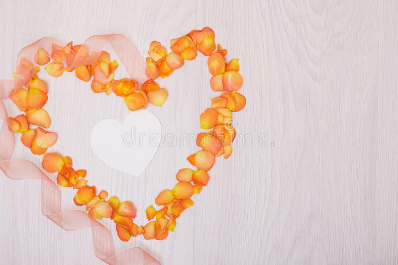 Flowers composition heart symbol made of dried flowers. Heart of rose petals royalty free stock photo
