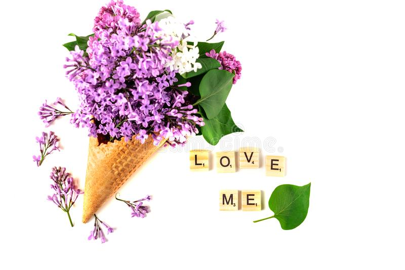 Flowers composition. Lilac in waffle cone. Flat lay, top view, copy space. Concept of proposal, love and tenderness. stock images