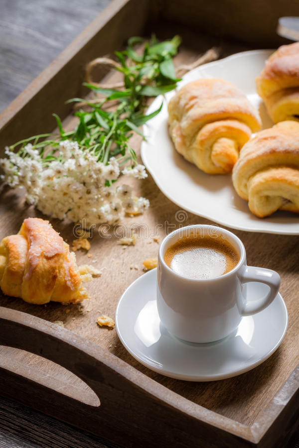 Flowers, croissant and coffee for breakfast royalty free stock images