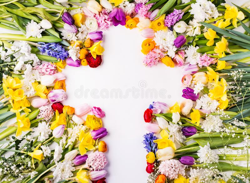 Flowers and cross Easter abstract concept on a white background. Copy space. royalty free stock images