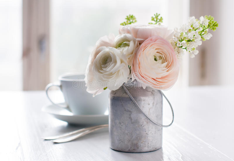 Flowers and cup stock images