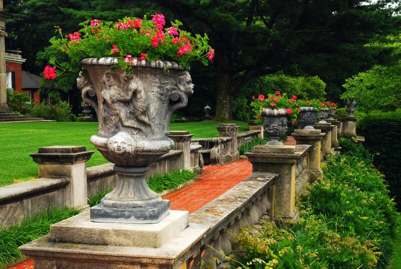 Flowers decorate a terrace of an estate. Flowers decorate a terrace of a historic estate in Old Westbury, New York royalty free stock photography