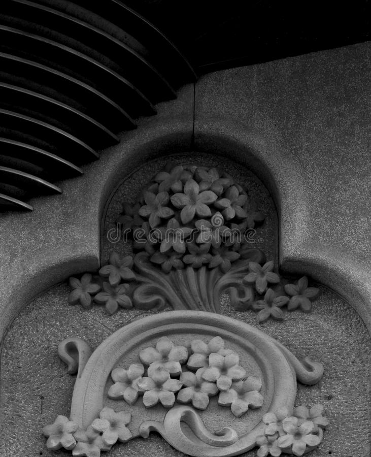 Flowers on detail. Shot in black and white, detail on an sculpture representing some nice flowers placed on the facade of this historic building Lleo Morera royalty free stock image