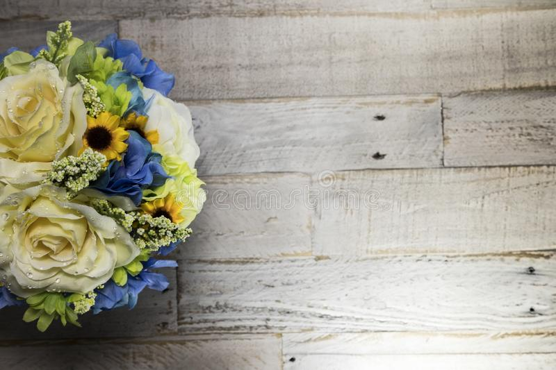 Flowers on Distressed Wood Surface Macro Left Side royalty free stock photo
