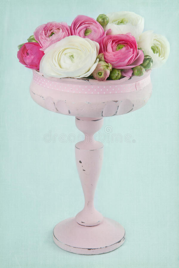 Flowers in an elegant pink tall vase stock photos