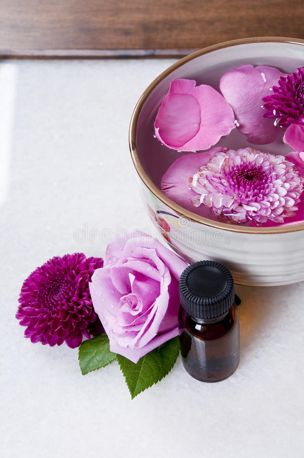 Flowers essence spa. (Girls in love ) flowers spa and essence royalty free stock image