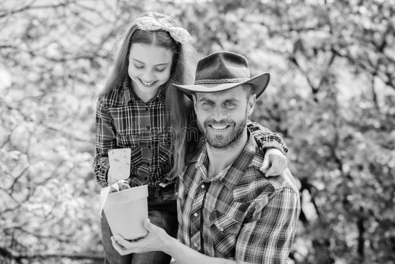 Flowers expert. ecology environment. soils and fertilizers. little girl and happy man dad. earth day. new life. family stock photo
