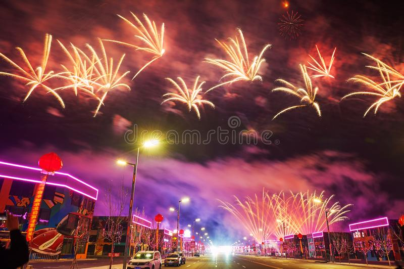 The flowers of fireworks reach on the Motor city. The photo was taken in Motor City of Daqing city,Heilongjiang province, China.It was setting off fireworks to royalty free stock photography