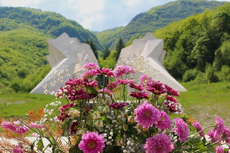 Flowers in front monument. stock photos