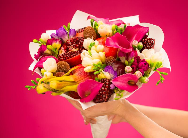Flowers, fruit bouquet, pink callas, garnet, lychees, freesia, p. Beautiful fresh spring exotic fruit flowers tropical bouquet: pink callas, garnet, lychees stock photos