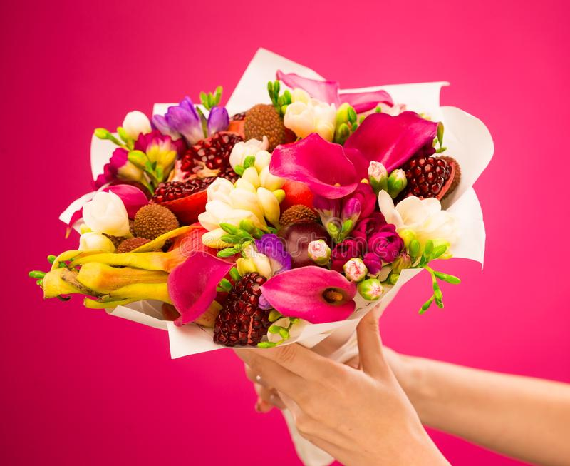 Flowers, fruit bouquet, pink callas, garnet, lychees, freesia, p. Beautiful fresh spring exotic fruit flowers tropical bouquet: pink callas, garnet, lychees royalty free stock image