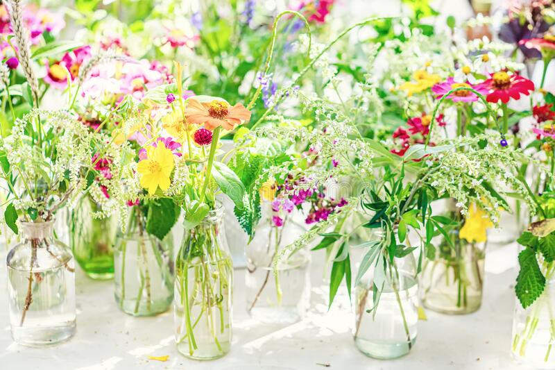 Flowers in a glass vase stock image