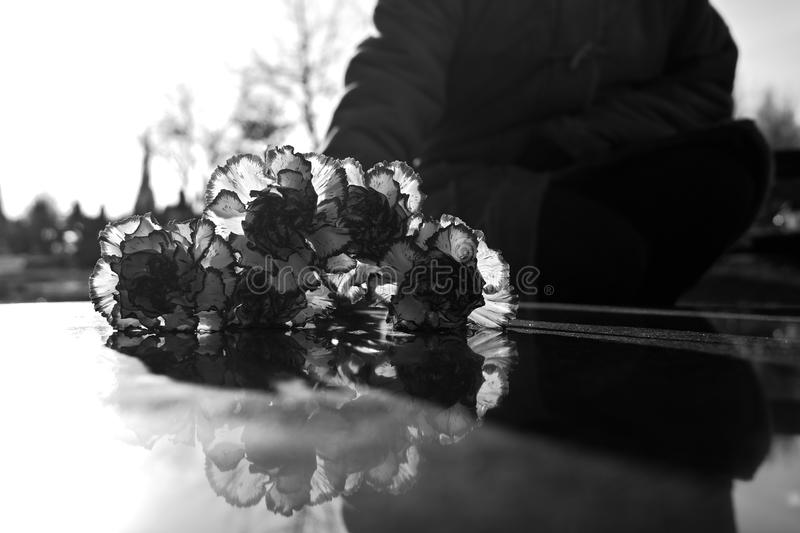 Flowers on the grave. In memory of the dead, flowers on the grave royalty free stock photos