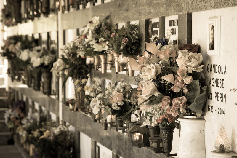 Flowers on graves, Italy stock photo