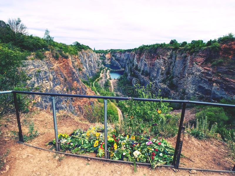 Flowers at handrail above old closed mine. Memory to victims royalty free stock image