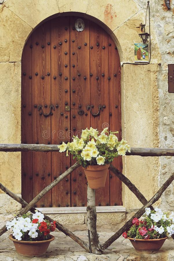 Flowers hanging on the wall. Plants pot hanging on the wall in the village Valldemosa, Mallorca island, Spain stock photos