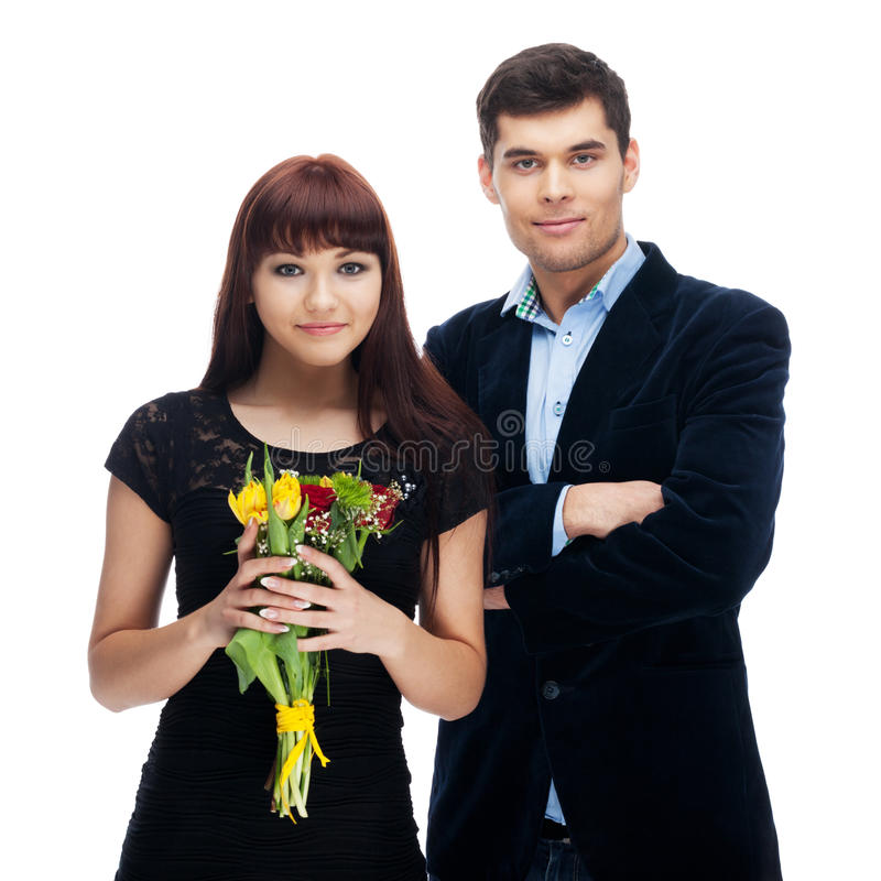 Flowers for her. Couple with flowers on isolated white royalty free stock photo