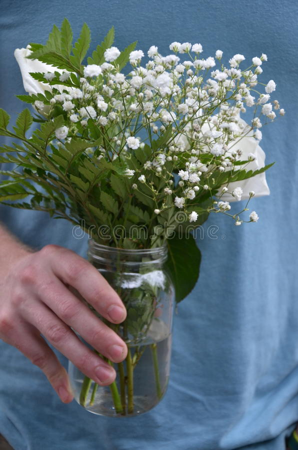 Flowers for her. Simple gifts for the love of his life to ask for her hand in marriage stock photos