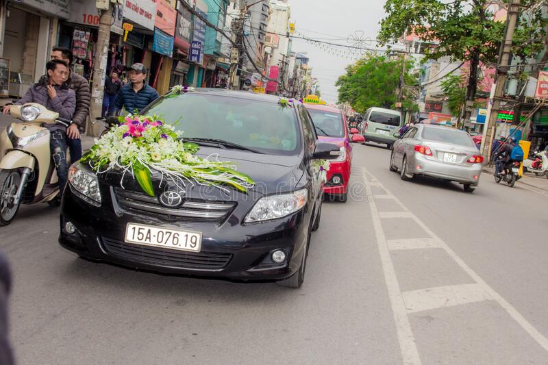 Flowers on hood of car stock image
