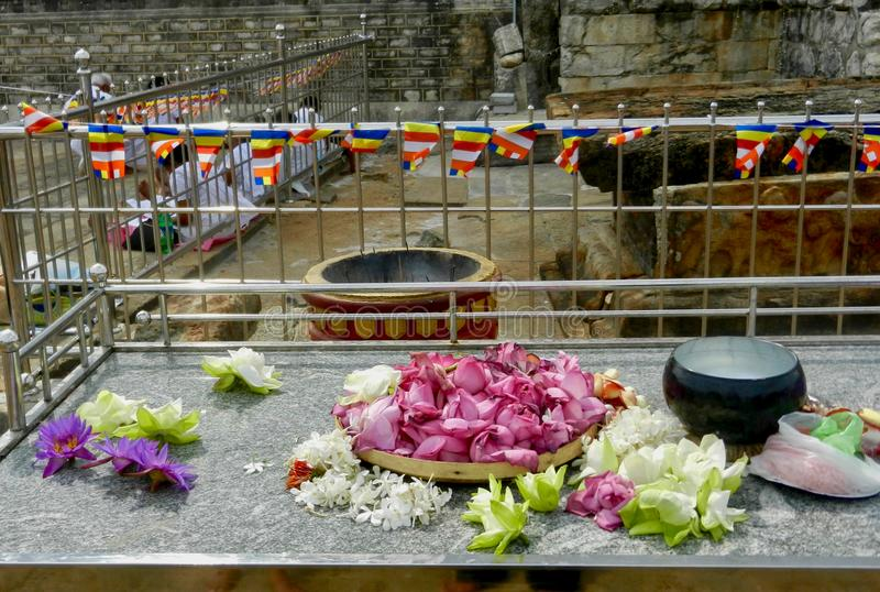 Offerings to god. Flowers and instances offered at the Ruwanwelisaya stupa, one of the World`s tallest religious monuments, situated in Anuradhapura, Sri Lanka stock photography