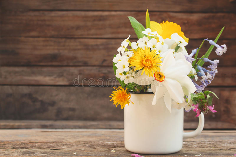 Flowers in an iron mug royalty free stock photography