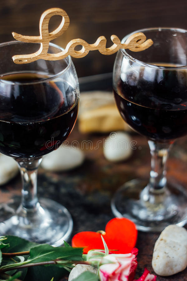 Flowers with letters LOVE on two glasses of cola.  royalty free stock images