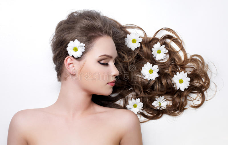 Download Flowers In Long Hair Of Teen Girl Stock Image - Image: 18832015