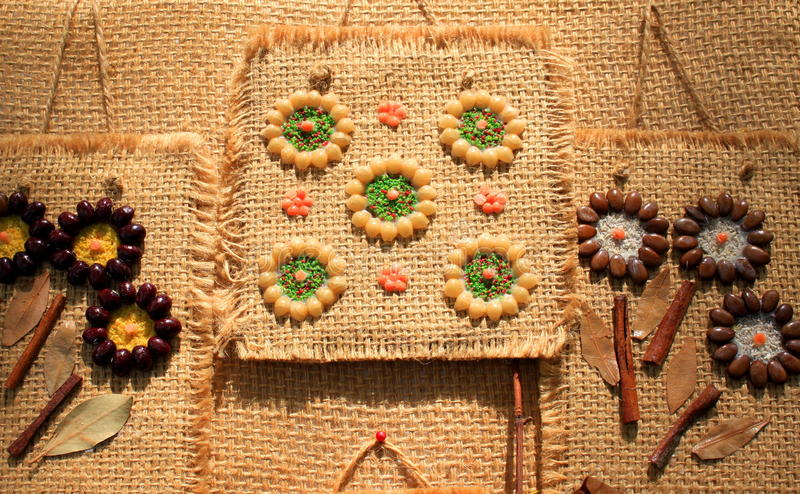Flowers made from seeds. And glued on canvas bag stock images