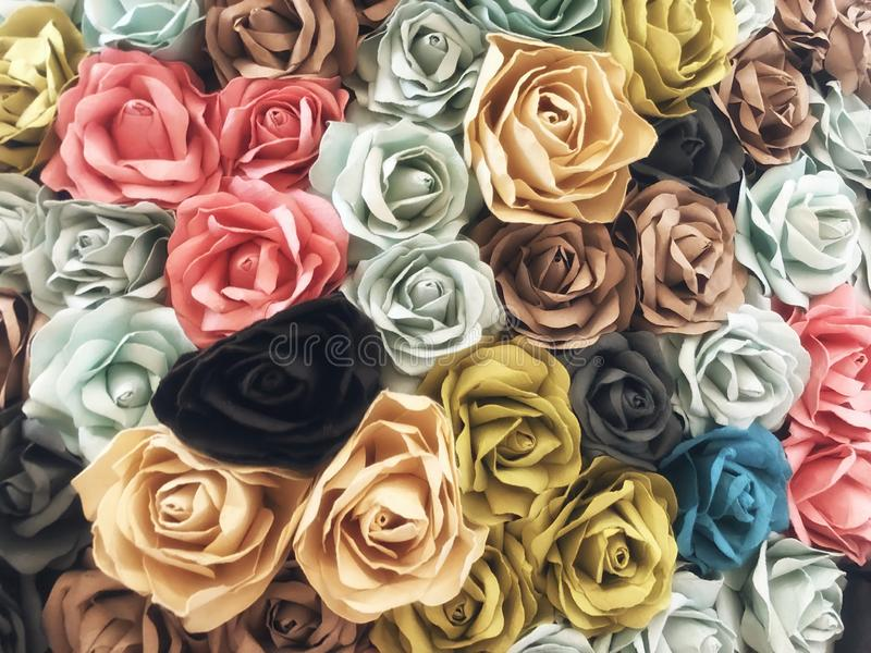Flowers made of paper are handicrafts decorative crafts on the walls  abstact background. Pastel colour royalty free stock photos