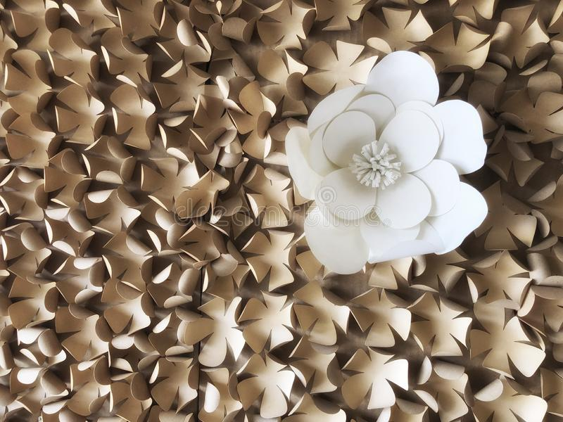 Flowers made of paper are handicrafts decorative crafts on the walls  abstact background. White and brown color royalty free stock photos