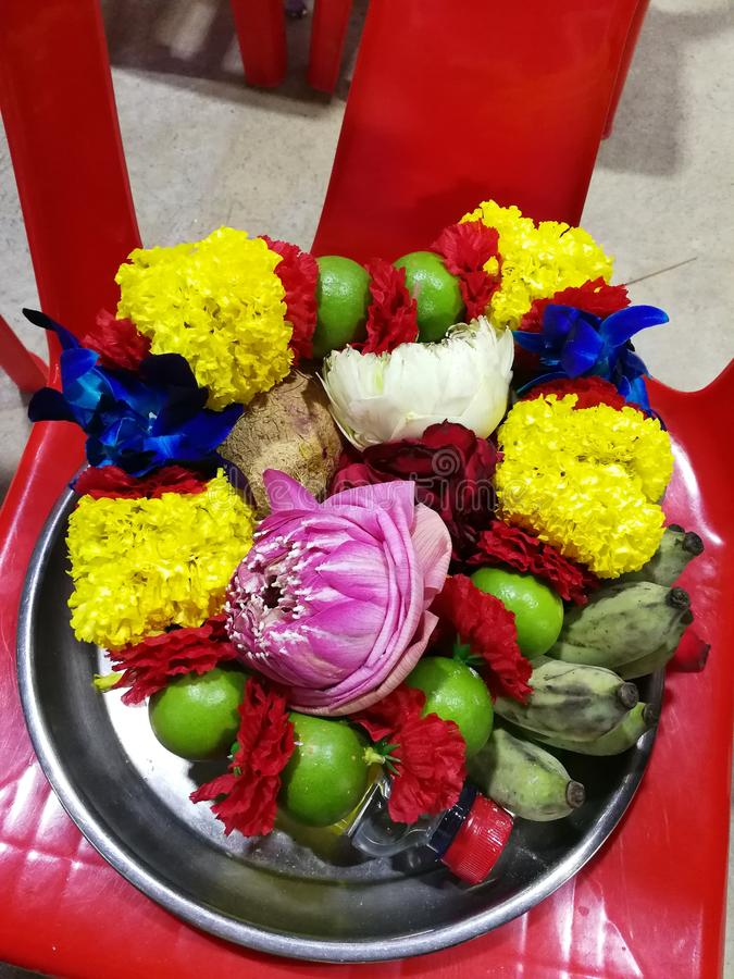 Flowers, marigolds, lotus, banana, coconut or fruit for the worship in Thailand Temple at Happy new year cerebation. Cornflowers, marigolds, lotus, banana royalty free stock photography