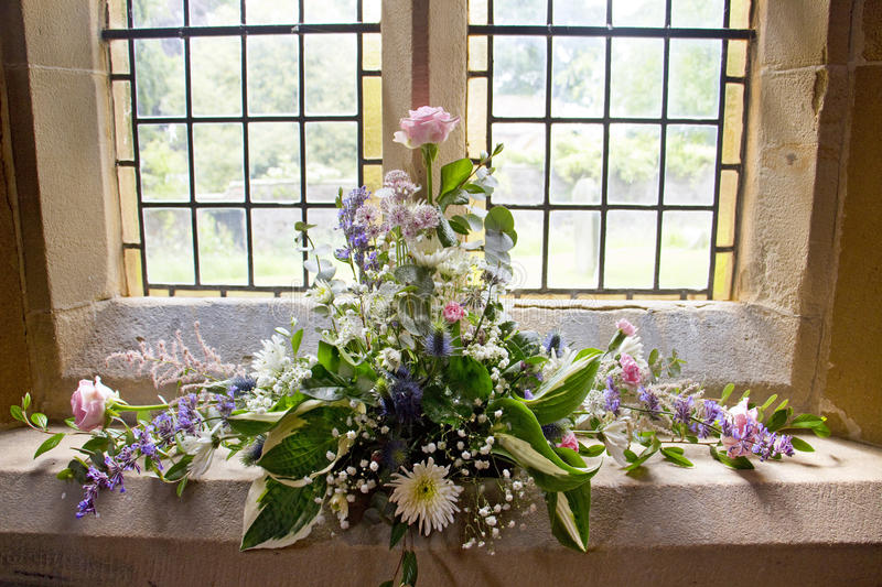 Flowers near a church window stock images
