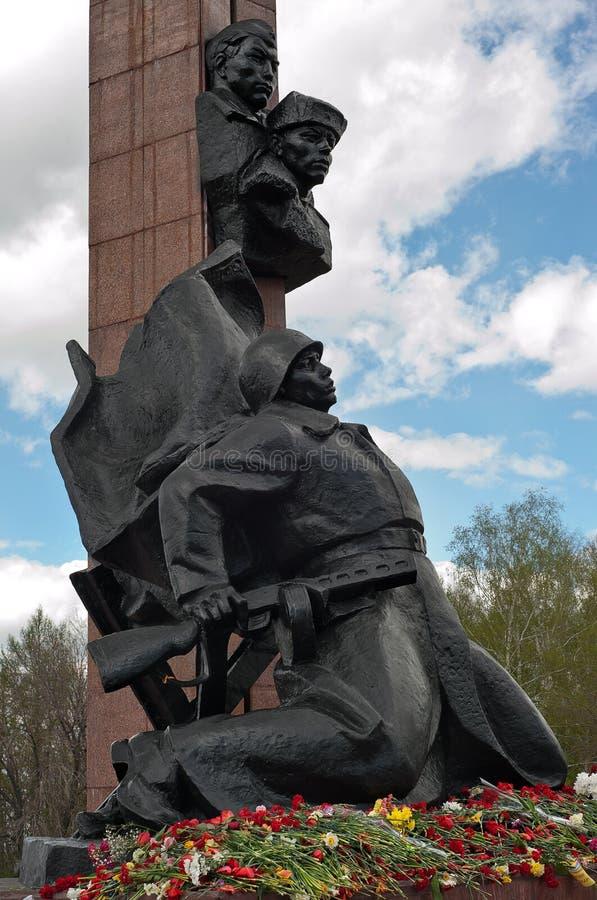 Flowers near Memorial to the Heroes of the Soviet Union Alexander Matrosov and M. Gubaidullin. World War II Memorial. May 9, Ufa, stock image