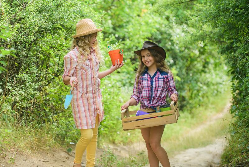 Flowers need our care. small girls farmer in village. happy farming. spring country side. earth day. summer family farm. Protect nature. Rich harvest. children royalty free stock photos