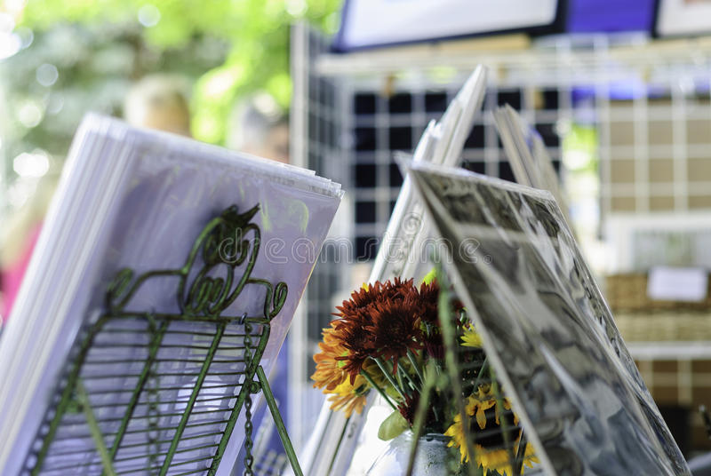 Flowers and photographs. On display at arts and crafts show stock images