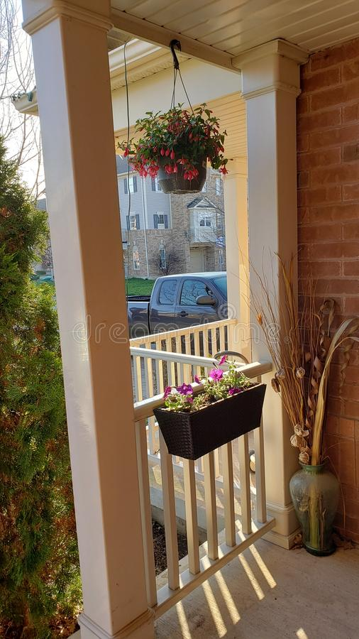 Flowers on a porch in Milton, Canada. Fresh flowers  on  a porch  in Milton, a suburban area in Ontario, Canada. Typical scenery in suburban areas royalty free stock photo