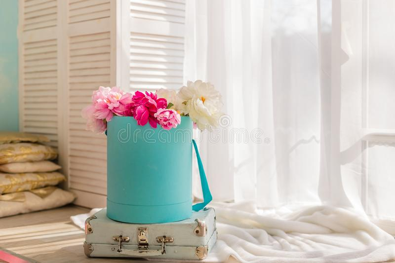 Flowers in round luxury present boxes. Bouquet of pink and white peonies in paper box. Mock-up of hat box of flowers stock photo