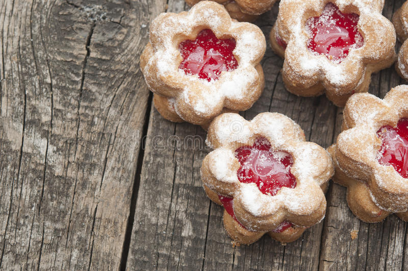 Flowers shape cookies. Jelly cookies flower with red jam homemade on vintage table top stock images