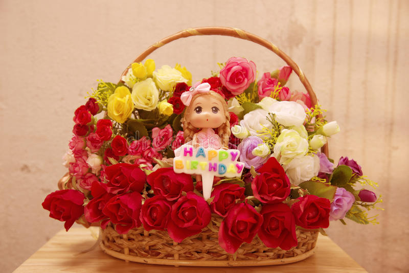 Flowers and stuffed with a badge Happy birthday stock images