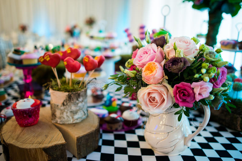Flowers and sweets stock image