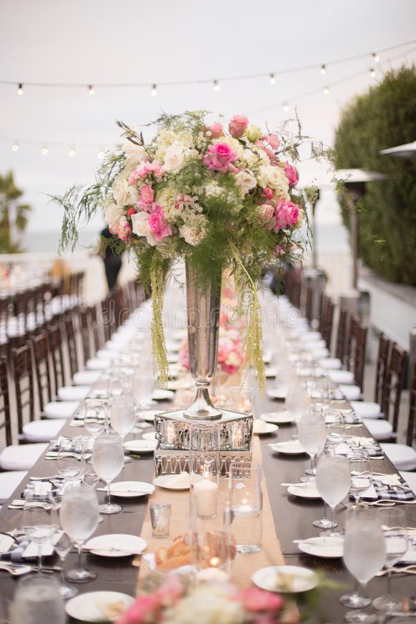Flowers on Table at a wedding reception stock photos