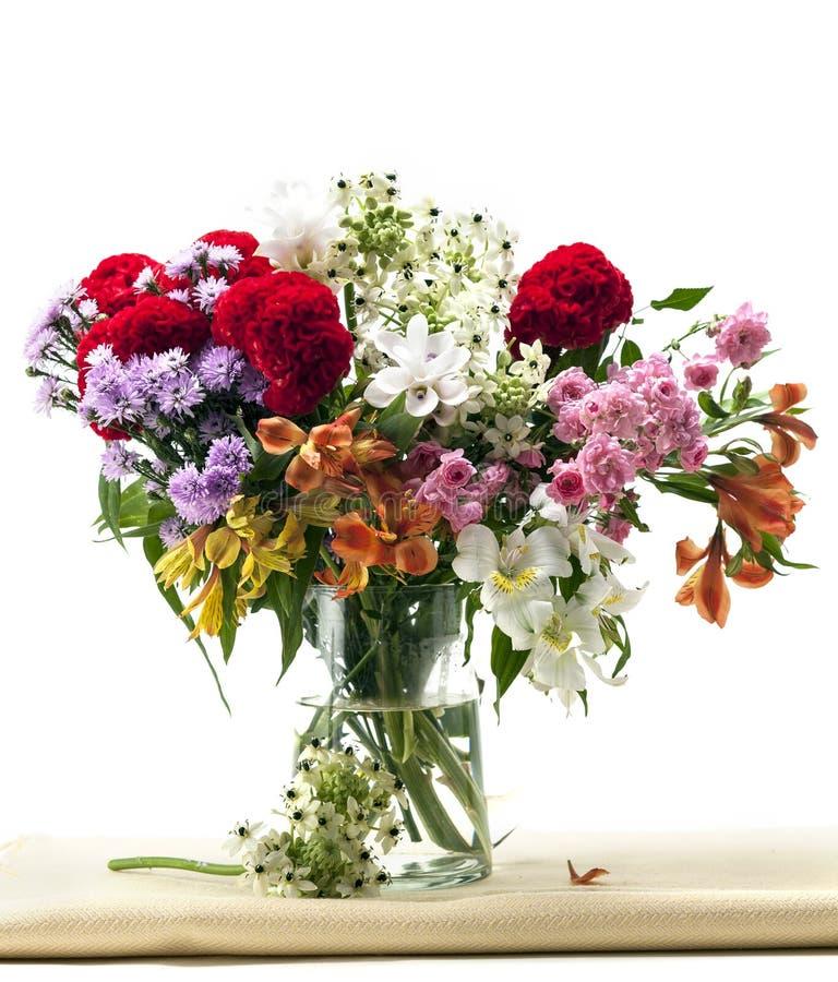 Flowers vase on fabric stock photography