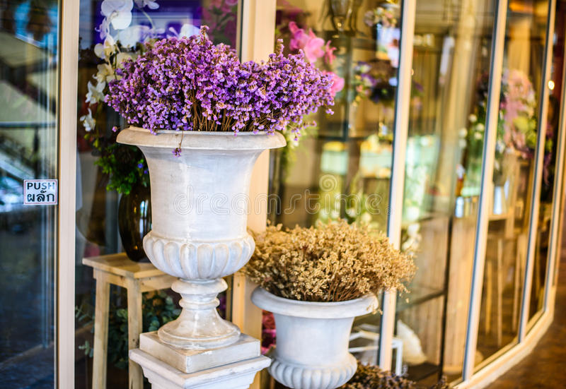 Flowers in vase outside of flower shop. Flowers in big vase outside of flower shop royalty free stock photography